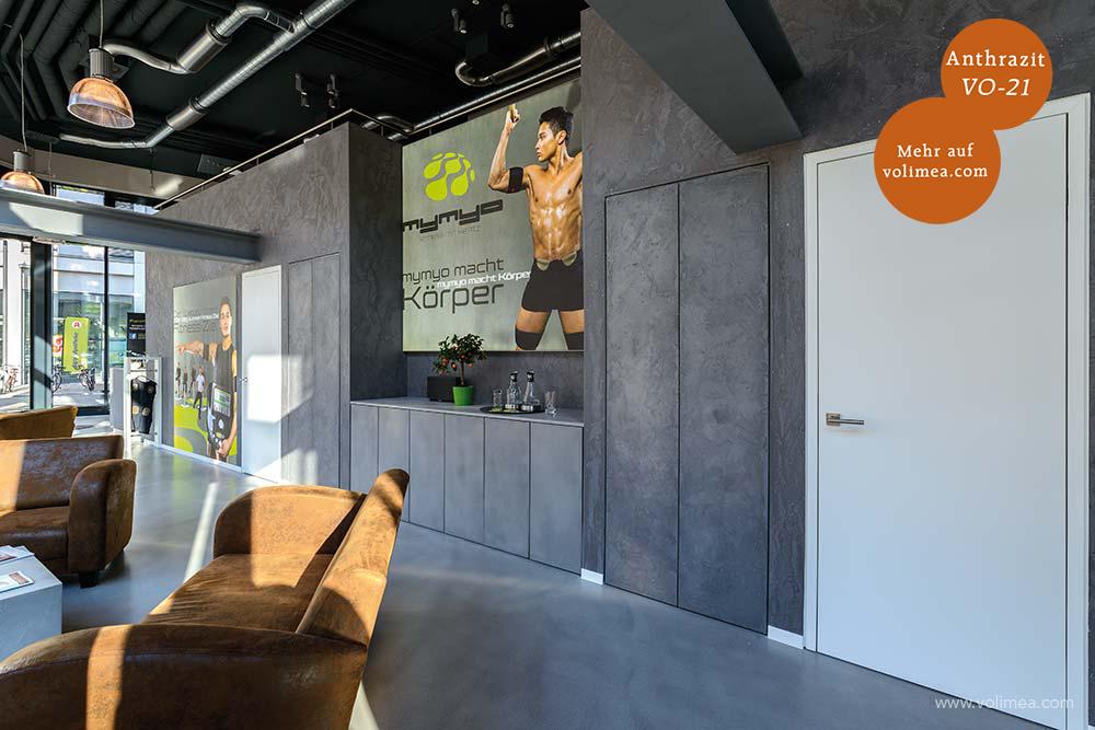 Mikrozement fugenlose Volimea Wandbeschichtung im Fitness-Bereich - Anthrazit VO-21